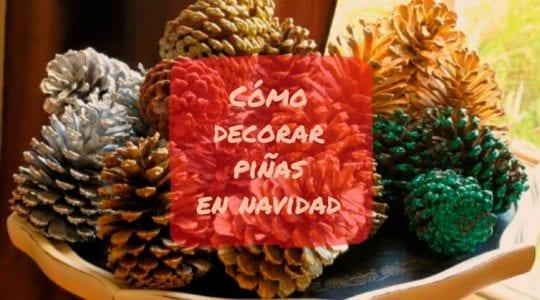como decorar piñas en navidad